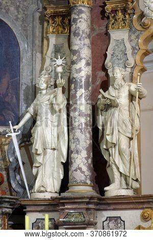ZAGREB, CROATIA - NOVEMBER 12, 2012: Saints Barbara and Joachim statue on the main altar in the Franciscan church of St. Francis Xavier in Zagreb, Croatia