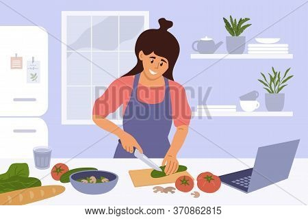 Cook Healthy Food At Home. Cute Girl Cooking Homemade Meals In Kitchen. Young Woman Watching Culinar