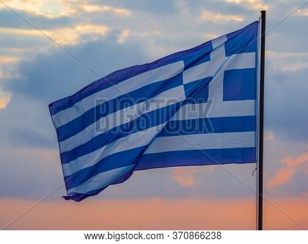 Greek Flag at sunset in Greece