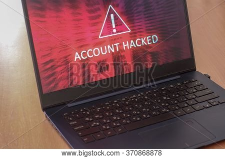 Hacked Account Concept On Laptop Screen With Red Background. Warning Triangular Sign With Exclamatio
