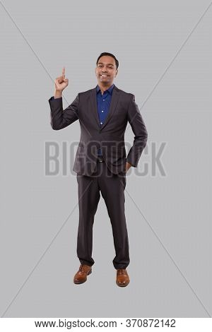Businessman Poiting Up Watching In Camera Isolated. Indian Man Standing Full Lenght