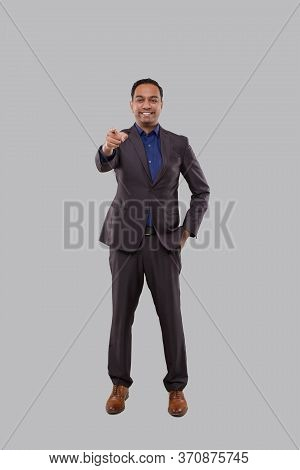 Businessman Poiting Front Watching In Camera Isolated. Indian Man Standing Full Lenght