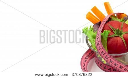 Measuring Tape, Vegetables And Salad. Diet Plan From Nutritionist. White Background. Close Up. Space