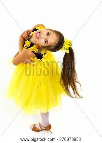 Portrait Of A Beautiful Little Girl Looking From Above. The Concept Of Happy People, Childhood. Isol