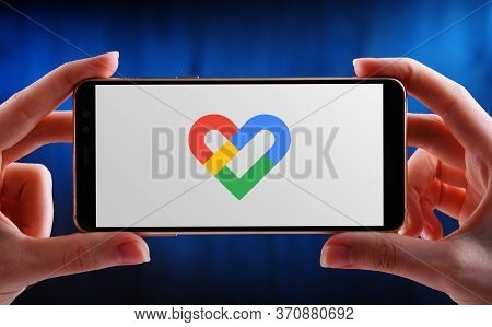 Poznan, Pol - May 21, 2020: Hand Holding Smartphone Displaying Logo Of Google Fit, A Health-tracking