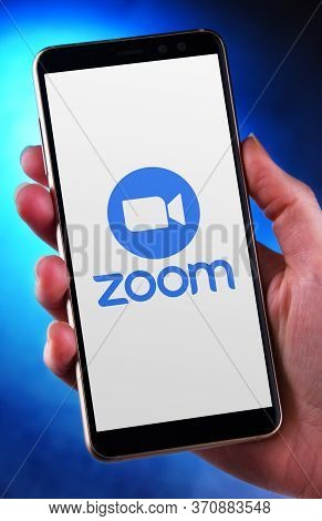 Poznan, Pol - May 21, 2020: Hand Holding Smartphone Displaying Logo Of Zoom, Videotelephony And Onli