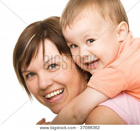 Portrait of happy son enjoying a piggyback ride on mothers back, isolated over white