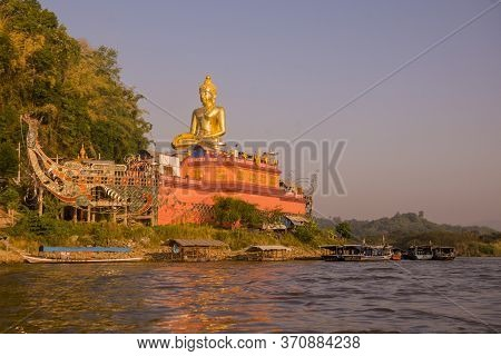 The Giant Buddha On The Dragon Boat Temple At The Mekong River In The Town Of Sop Ruak In The Golden