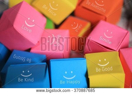 Colorful  Smiling Gift Boxes Background With Positive Motivational And Inspirational Single Words On