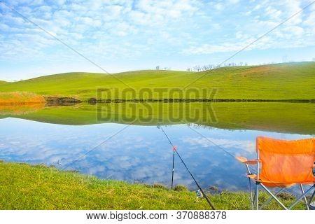 Fishing On The Moning Lake At Sunrise