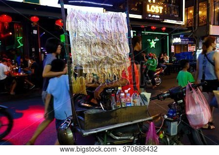 Ho Chi Minh City, Vietnam - March 27, 2019: Night Life And Local Cuisine On The Famous Road Bui Vien