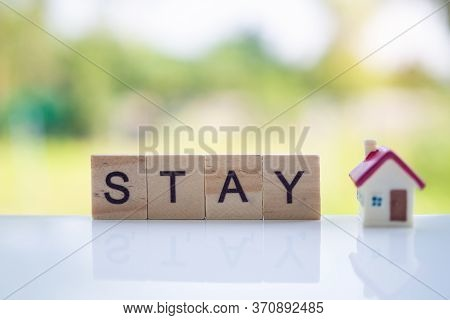 The Letters In The Wooden Blocks Say Stay At Home. Controlling Yourself At Home Is A Preventive Meas