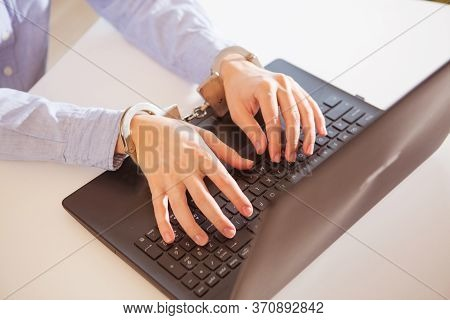 Woman Hands Locked To Laptop By Chain On Keyboard Of Notebook