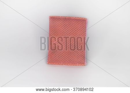 Old Sponge For Washing Dishes, Pink Sponge Looks Through Use And Has A Net Covering The Sponge And T