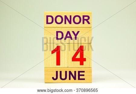 June 14, Donor Day Is Written On Wooden Blocks And Cubes On A White Background. World Blood Donor Da