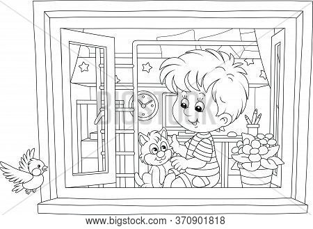 Cheerful Little Boy Playing With A Cute Small Kitten On A Windowsill In His Nursery Room And Looking