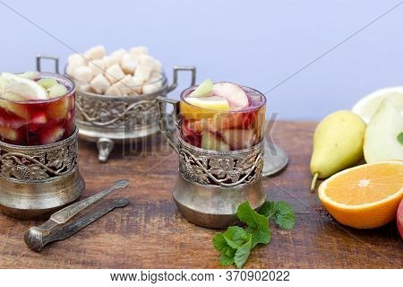 Cold, Refreshing Sangria In A Rustic Glass And Silver Details