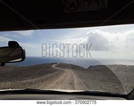 Path Leading To The Ocean Through Car Window. To The Uncertain Future, Ready For Adventure And New C