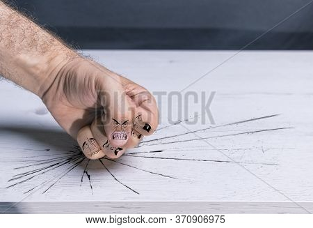Fist Hitting Table With Violence, With Cartoons On The Fingers Simulating Bullying, Male Violence, G