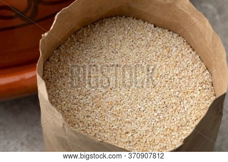Paper bag with barley grits, belboula, close up