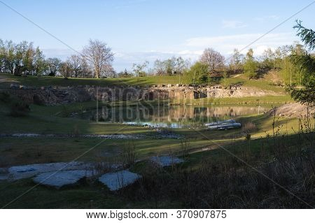 Some Canoes Parked In Front Of A Pond In An Old Stone Quarry In The Hiking Area Of Skrylle In Skåne