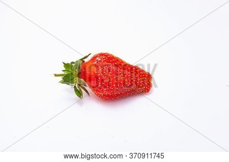 Ripe Strawberries Close-up. Fresh Berry Strawberry With Green Leaf. Fruity Still Life Healthy Food.