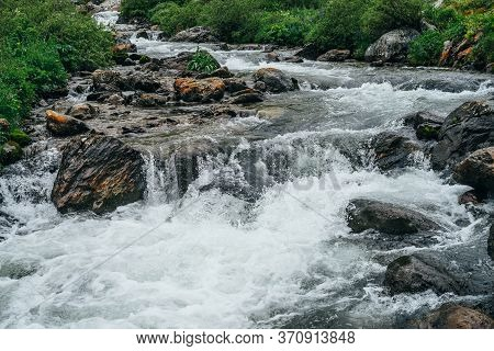Atmospheric Landscape With Big Stones In Mountain River. Powerful Water Stream Among Boulders In Mou
