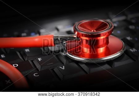 A Red Stethoscope And Keypad Represent The New Age Digital Doctors Appointments More Commonly Seen T
