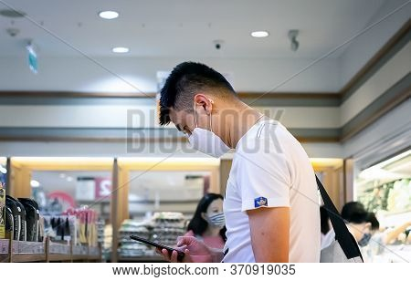 Bangkok, Thailand - June 11: Unnamed Man Shops In Foodland Supermarket With Face Mask And Mobile In