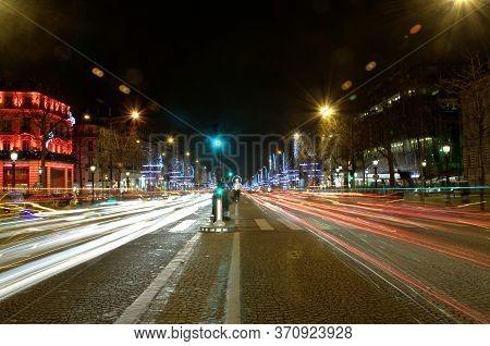 Champs Elysees By Night. Paris France Avenue In Light Illumination. Tourism Destination.