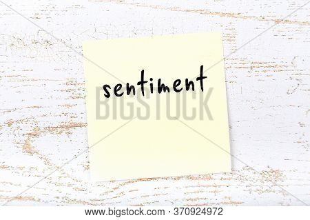 Concept Of Reminder About Sentiment. Yellow Sticky Sheet Of Paper On Wooden Wall With Inscription