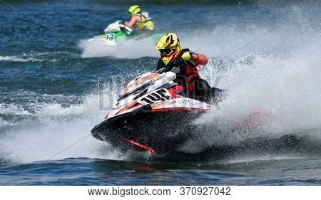 Wyboston, Bedfordshire, England -  May  12, 2019: Two Jet Ski  Race Competitors Creating At Lot Of S