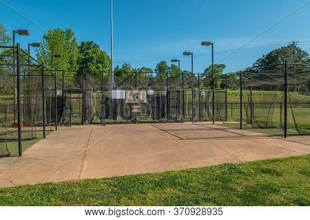 Empty And Vacant Batting Cages At A Baseball Softball Field In A Park Closed Due To The Covid-19 Pan