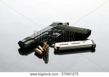 Hefty 1911 Semi Automatic Handgun Unloaded Next To 8 Round Magazine And 4 Loose Hollow Point Bullets