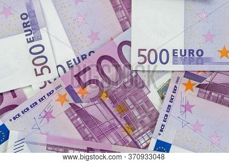 Banknotes Of Five Hundred And 500 Euros Are Scattered In A Chaotic Manner. European Currenc Lies On