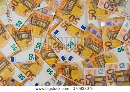 Banknotes Of 50 Fifty Euros Are Scattered In A Chaotic Manner. European Currenc Blank For Design, Ba