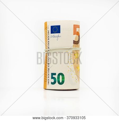 Banknotes Fifty 50 Euros In A Roll With An Elastic Band. European Currenc To Save. Close-up, White B