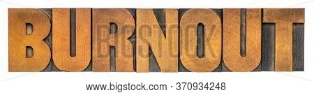 burnout - isolated word abstract in vintage letterpress wood type, emotional, mental, or physical exhaustion concept