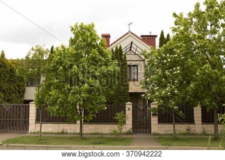A Private Secluded Cozy Small House, A Manor With A Red Triangular Roof, Hid Behind Green Flowering