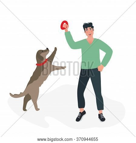The Dog Handler Trains The Dog And Teaches Its Commands. Playing With A Labrador. Dog Breeding And B