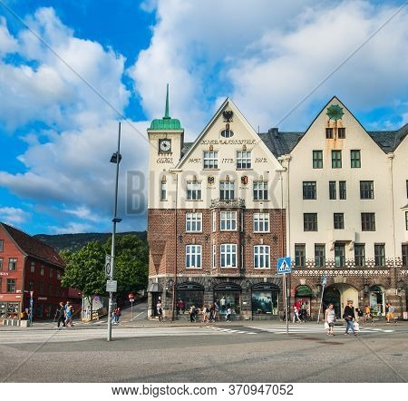 Bergen, Norway - August 1, 2018: Tourists Visiting And Enjoying Norwegian Traditional Old Town Pier