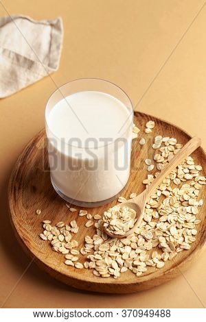 Vegan Oat Milk, Non Dairy Alternative Milk In A Glass. Vegan Non Dairy Alternative Milk. Oat Flakes