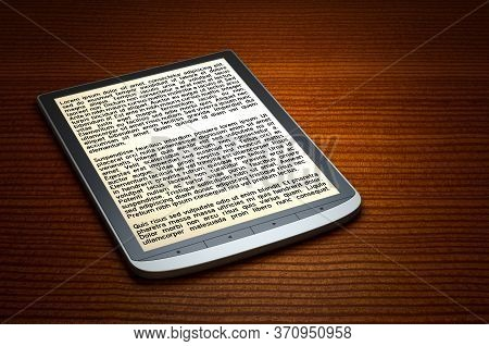 E-book Reader On The Wooden Table, 3d Rendering
