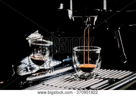 Dark Coffee Pouring In A Transparent Glass Espresso Cup From A Manual Espresso Machine, With Copy Sp