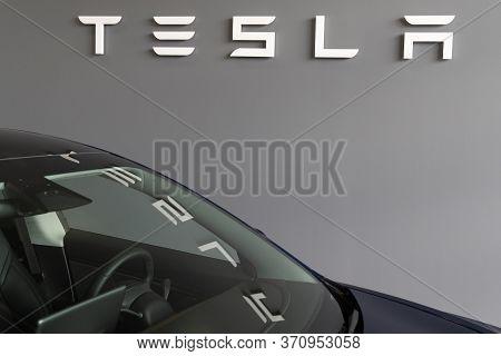 Bordeaux , Aquitaine / France - 11 13 2019 : Tesla Store Logo Sign Dealership Reflection In Model 3