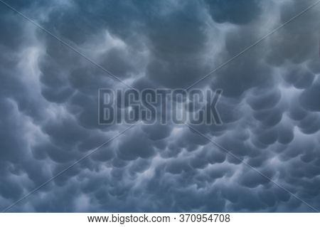 Menacing Mammatus Clouds Before The Storm, Stormy Sky, Climate Change And Unpredictable Terrifying M