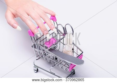 Nail Polish, Scissors, Nail File, Shopping Cart With Cosmetics. Online Cosmetics Store For Women. Sh