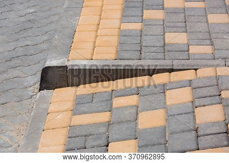 Ramp For The Descent Of Wheeled Vehicles From The Pedestrian Sidewalk Onto The Road Paved With Stone