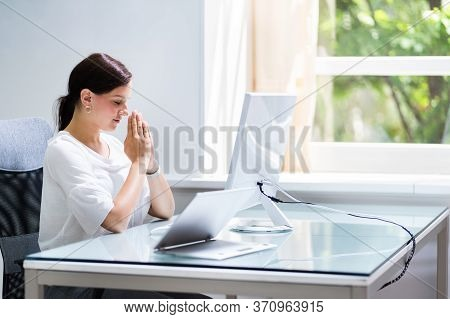 Doubtful Upset Business Woman At Computer Pondering And Confused