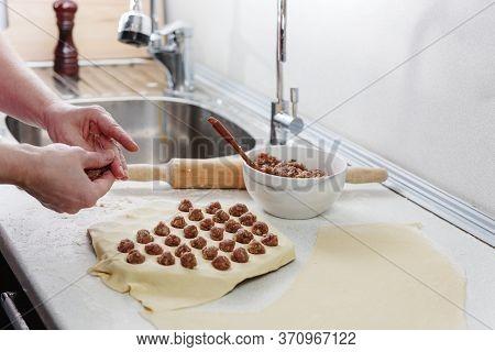 Sculpt Dumplings. Homemade Meat Dumplings. Prepare Homemade Dumplings On The Table, Sprinkled With F